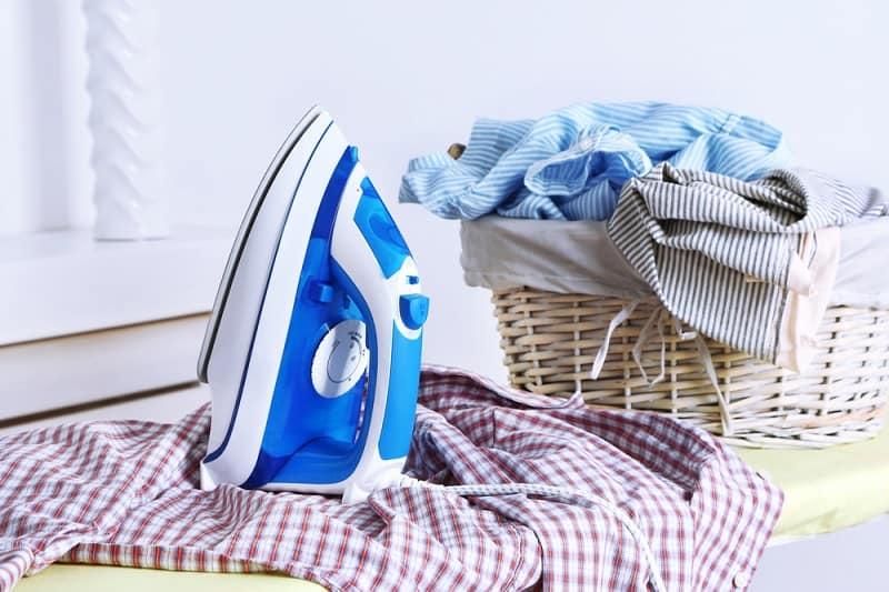 Iron and Pile of Washing