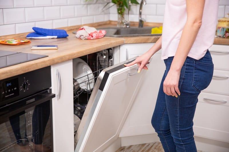 Women opening dishwasher