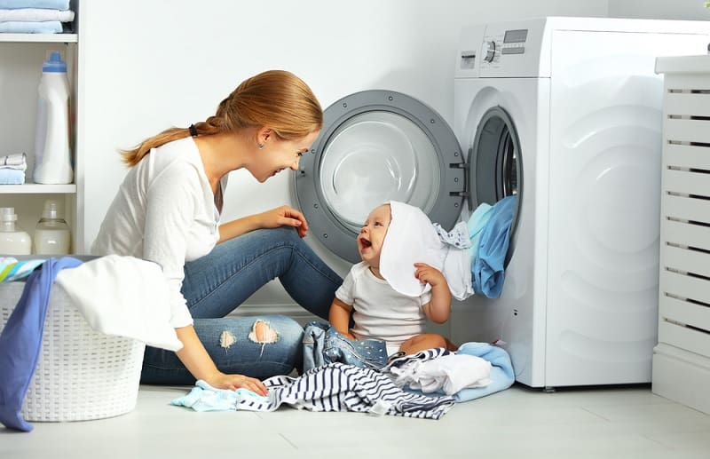 Mother and baby doing laundry