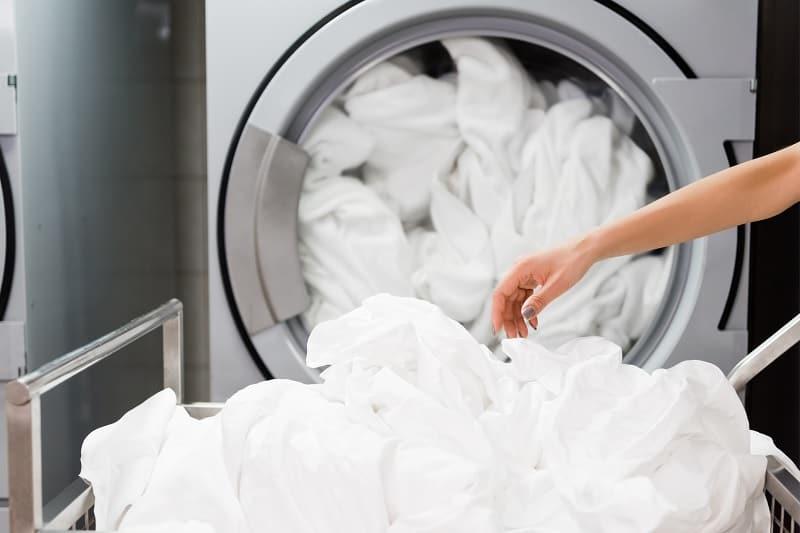 Putting sheets in washing machine
