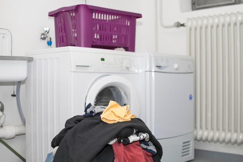 Tumble Dryer With Pile of Washing