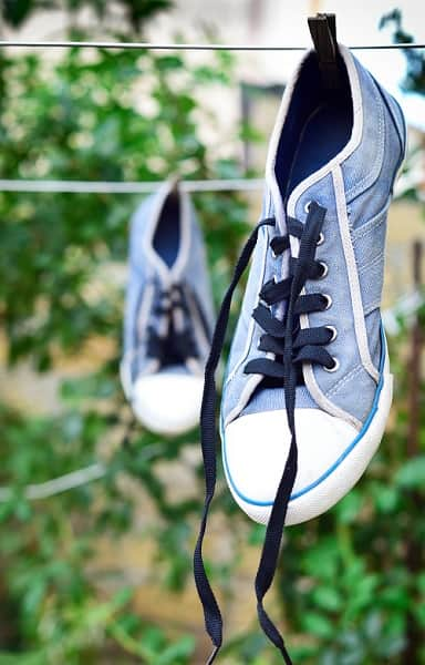 Pair of trainers drying outside on a washing line