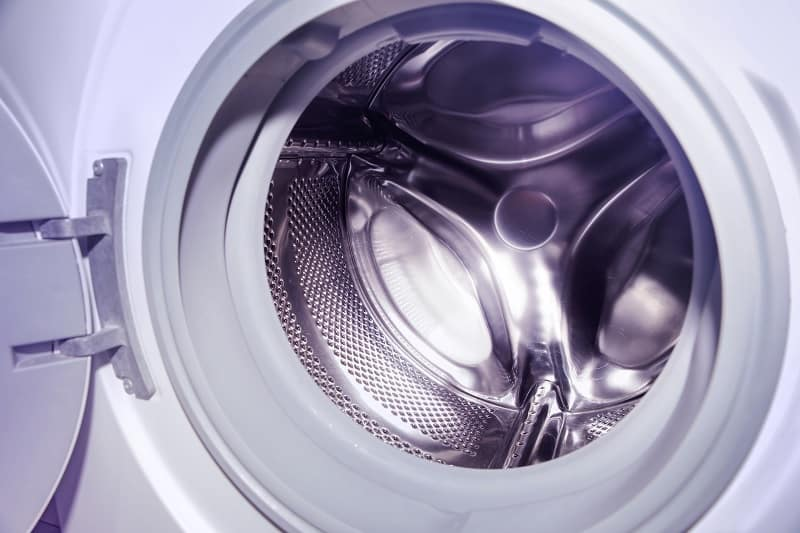 Inside of clean and sparkling washing machine drum