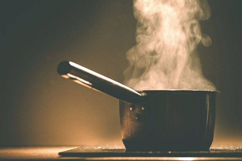 Steaming hot pan of water