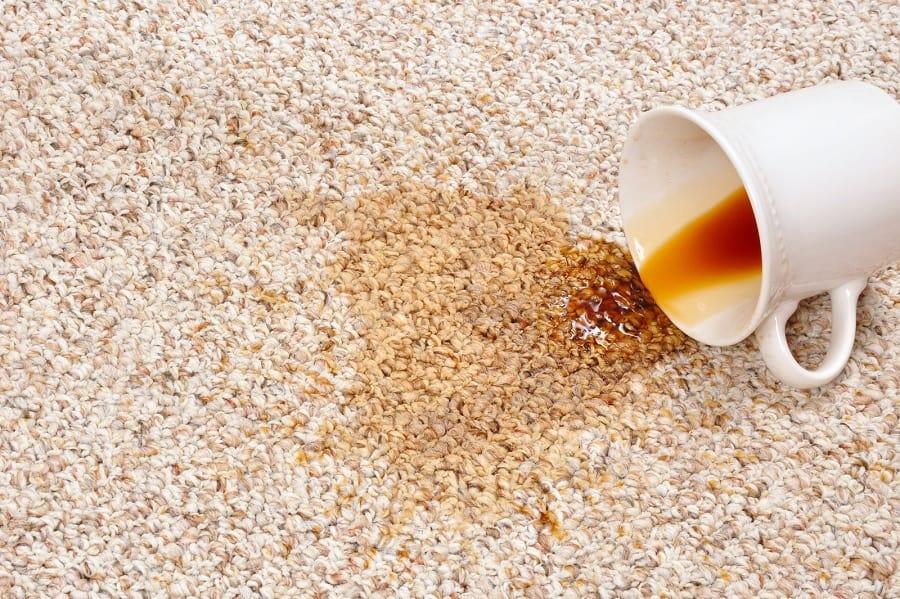 Cup of tea spilt on carpet