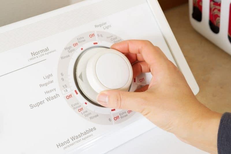 turning washing machine dial to off
