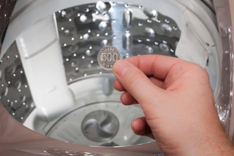 Coin on Washing Machine