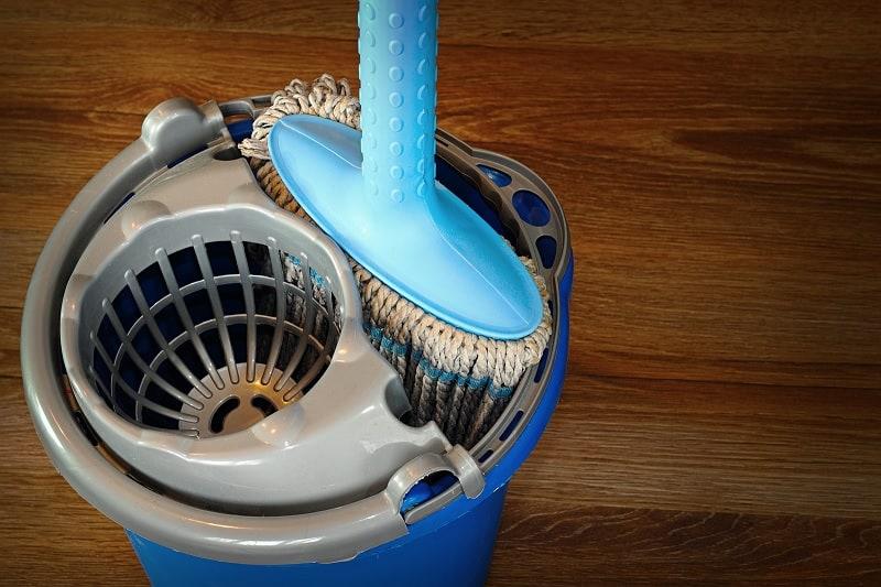 Mop and bucket on wood floor