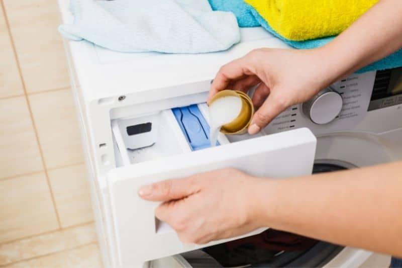 Pouring Liquid Detergent into the Detergent Drawer