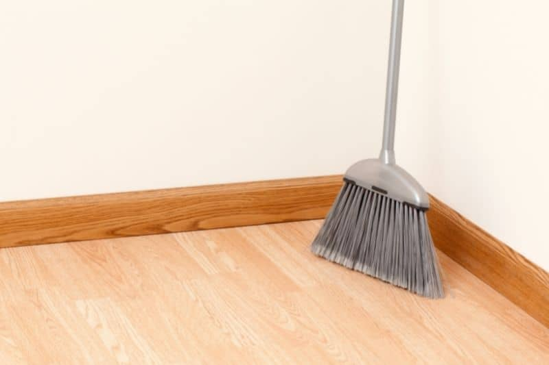 Using Indoor Broom in Cleaning Laminate Floors