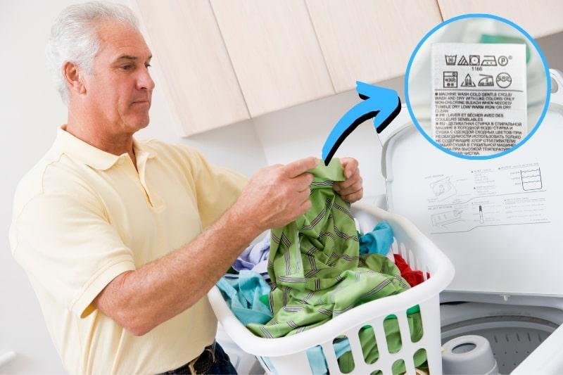 man reading washing instructions