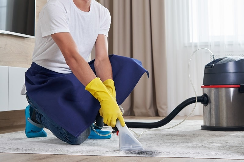 man with carpet cleaner