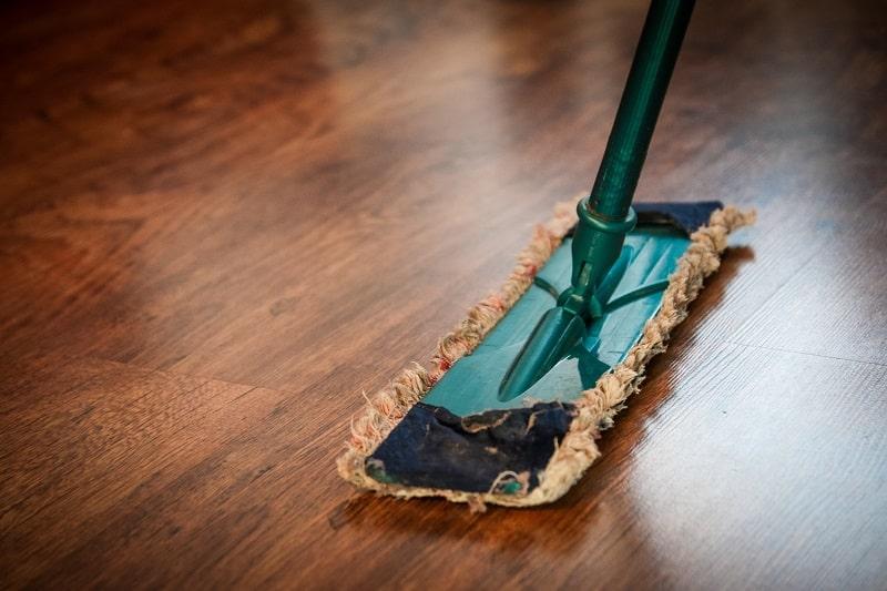 using a mop to clean wet floor