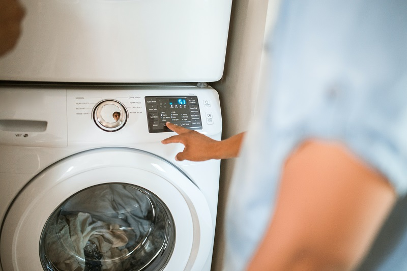 using washing machine to clean clothes