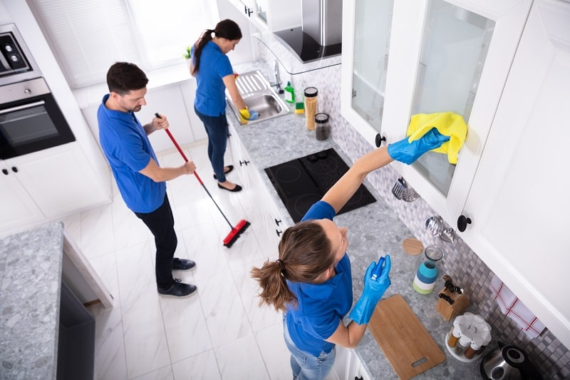 cleaning services staff in the kitchen