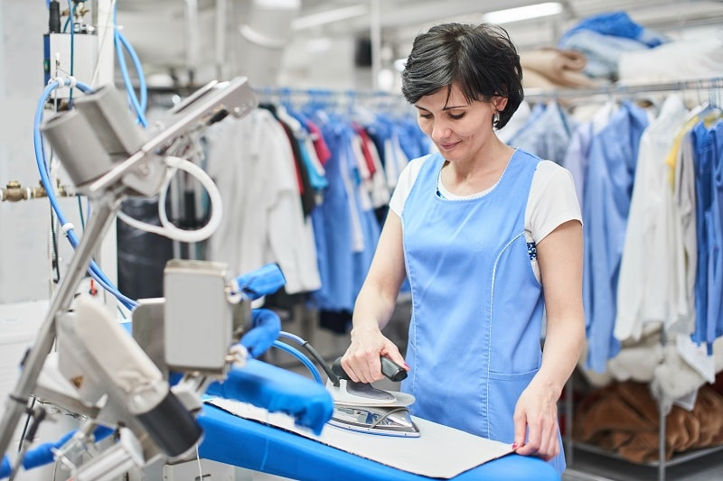 woman doing ironing services