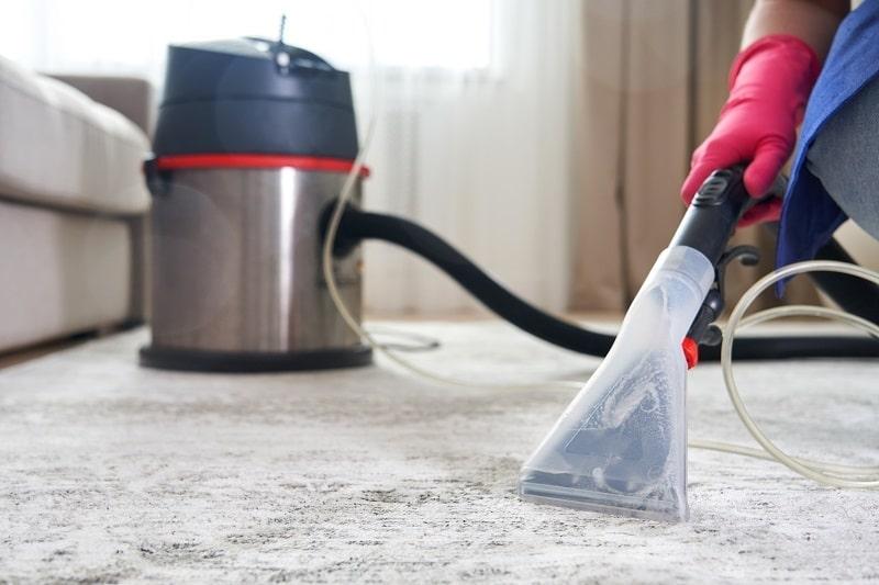 using carpet cleaner in living room