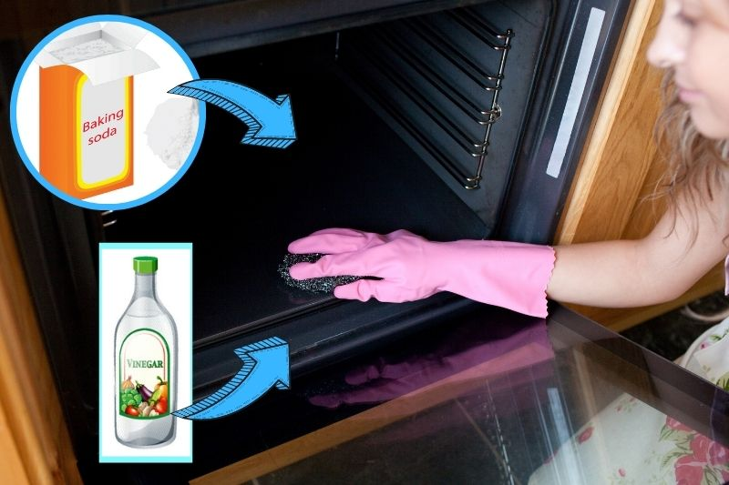 woman cleaning the inside of oven